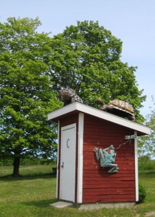 Critters on the wellhouse