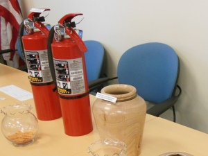 Fire extinguishers and turned wood vase