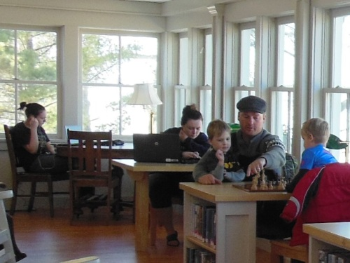 Chess lessons on the porch - Elk Rapids Library